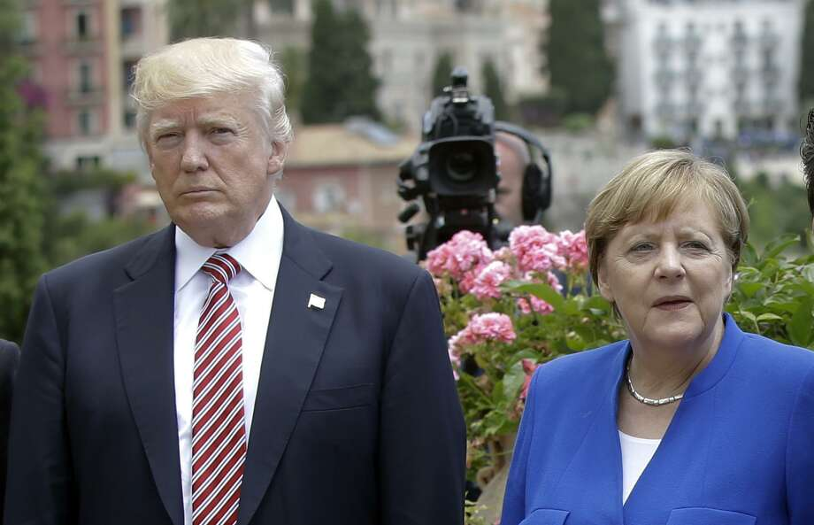 President Donald Trump is flanked by German Chancellor Angela Merkel during the G7 meeting in Italy on May 26. His European and Mideast trip was a disaster for U.S. interests. Photo: Luca Bruno /Associated Press / Copyright 2017 The Associated Press. All rights reserved.