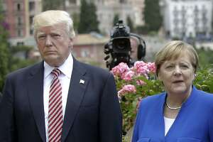 President Donald Trump is flanked by German Chancellor Angela Merkel during the G7 meeting in Italy on May 26. His European and Mideast trip was a disaster for U.S. interests.