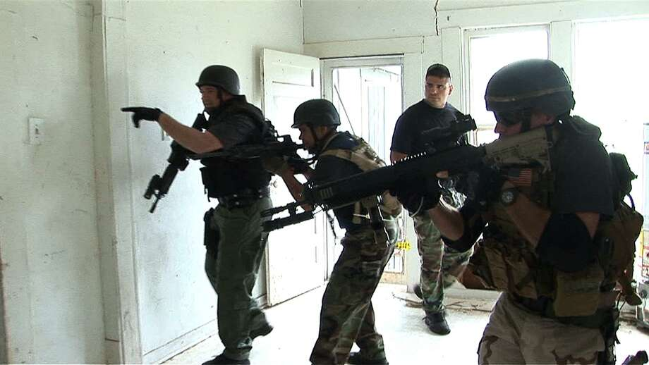 Students in a basic SWAT training course practice safely clearing rooms. San Antonio is receiving $1 million from the Urban Area Security Initiative, which is geared toward training and equipping first responders in urban areas that are deemed to be at high risk for acts of terrorism. Photo: San Antonio Express-News File Photo / agrant@express-news.net