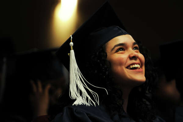 Jenessya Bujosa smiles during the Bridgeport Adult Education graduation at the Klein Memorial Auditorium in Bridgeport, Conn. June 6, 2017.