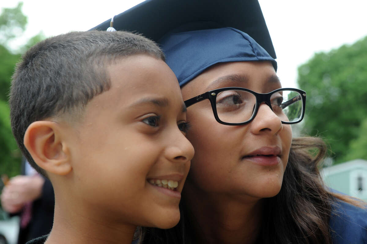 Meliisa Santiago poses for a photograph with her son, Jarrell Torres, 10, at the Bridgeport Adult Education graduation at the Klein Memorial Auditorium in Bridgeport, Conn. June 6, 2017.