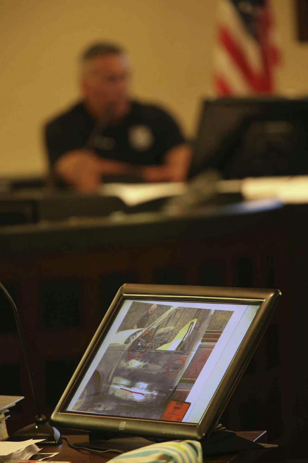 Photographs from the scene are introduced as evidence Tuesday during the second day of the murder trial of Joel Soto. San Antonio Fire Department Arson Investigator Juan Martinez is on the witness stand.