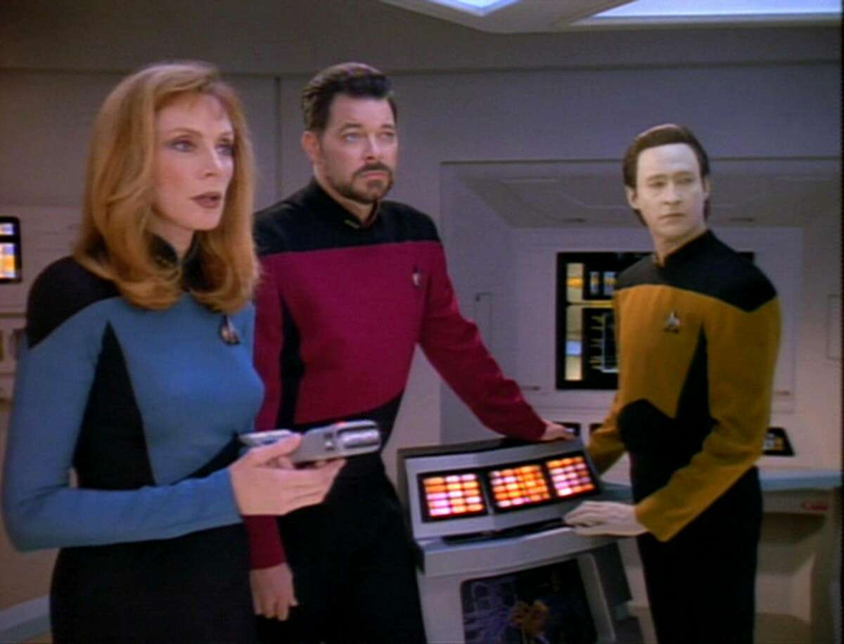 From left, actors Gates McFadden (as Doctor Beverly Crusher), Jonathan Frakes (as Commander William T. Riker), and Brent Spiner (as Lieutenant Commander Data).