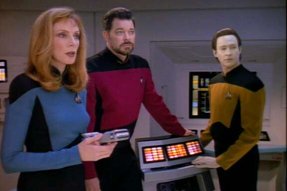 From left, American actors Gates McFadden (as Doctor Beverly Crusher), Jonathan Frakes (as Commander William T. Riker), and Brent Spiner (as Lieutenant Commander Data) in a scene from an episode of the television series 'Star Trek: The Next Generation' entitled 'Interface,' California, October 4, 1993. (Photo by CBS Photo Archive/Getty Images)