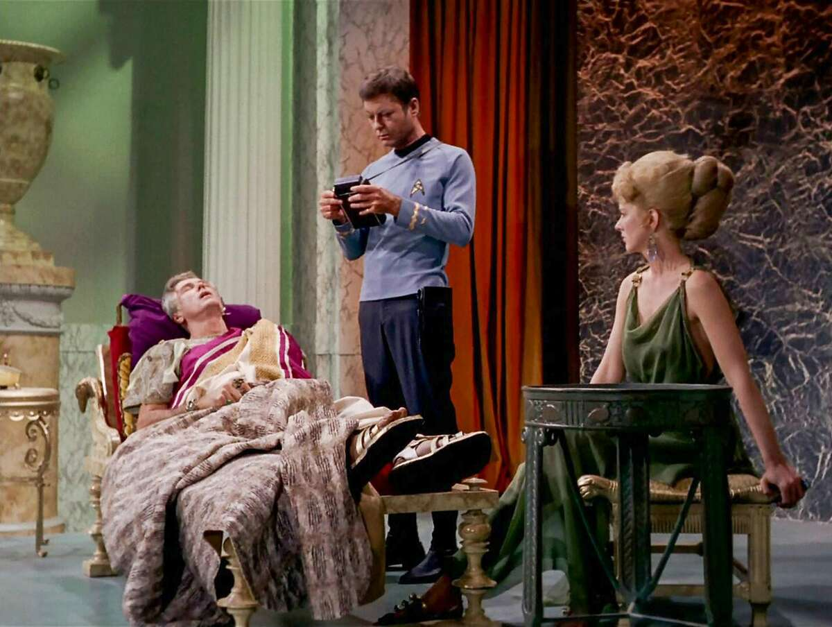 LOS ANGELES - NOVEMBER 22: Liam Sullivan as Parmen, DeForest Kelley as Dr. Leonard H. McCoy and Barbara Babcock as Philana in the STAR TREK episode, 'Plato's Stepchildren.' Original air date, November 22, 1968. Season 3, episode 10. Image is a screen grab. (Photo by CBS via Getty Images)