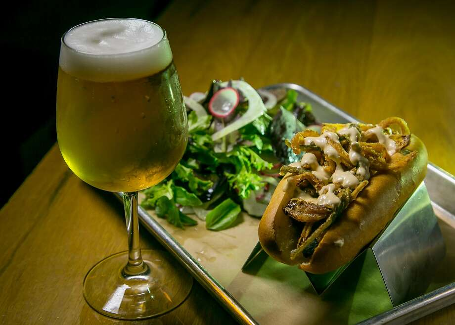 "The Texas Ranger Dog with a salad and a Mikkeller ""Hop On Drinkin Berliner"" at Mikkeller Bar in San Francisco, Calif., is seen on June 6th, 2017. Photo: John Storey, Special To The Chronicle"