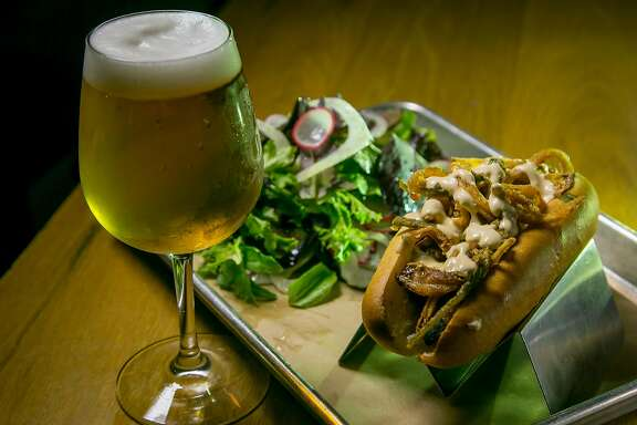 "The Texas Ranger Dog with a salad and a Mikkeller ""Hop On Drinkin Berliner"" at Mikkeller Bar in San Francisco, Calif., is seen on June 6th, 2017."