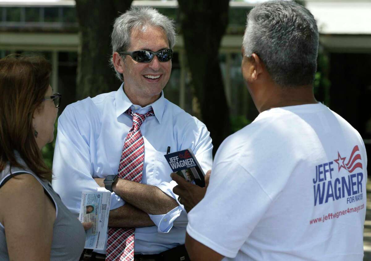 Jeff Wagner, left, talks to a supporter during his recent campaign for mayor of Pasadena. Wagner will be sworn in Saturday.