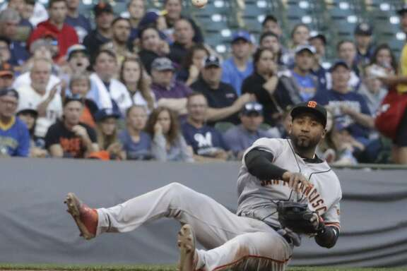 San Francisco Giants' Eduardo Nunez throws out Milwaukee Brewers' Jett Bandy from the ground during the third inning of a baseball game Tuesday, June 6, 2017, in Milwaukee. (AP Photo/Morry Gash)