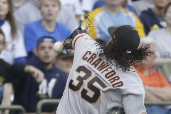 San Francisco Giants' Brandon Crawford can't handle a ball hit by Milwaukee Brewers' Eric Sogard during the second inning of a baseball game Tuesday, June 6, 2017, in Milwaukee. (AP Photo/Morry Gash)