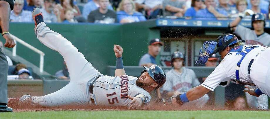 The Houston Astros' Carlos Beltran scores ahead of the tag from Kansas City Royals catcher Salvador Perez, right, on a two-run single by Yuli Gurriel in the third inning at Kauffman Stadium in Kansas City, Mo., on Tuesday, June 6, 2017. Photo: John Sleezer, TNS / Kansas City Star