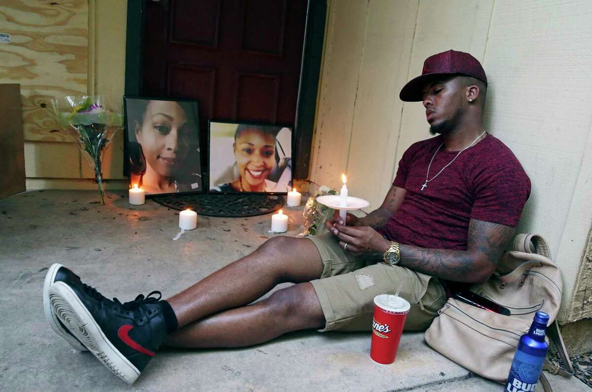 Theo Johnson sits quietly near the doorway of his slain cousin as friends and family gather on June 6, 2017 to remember in a prayer vigil April Russell who was fatally shot by her ex boyfriend on on Monday.