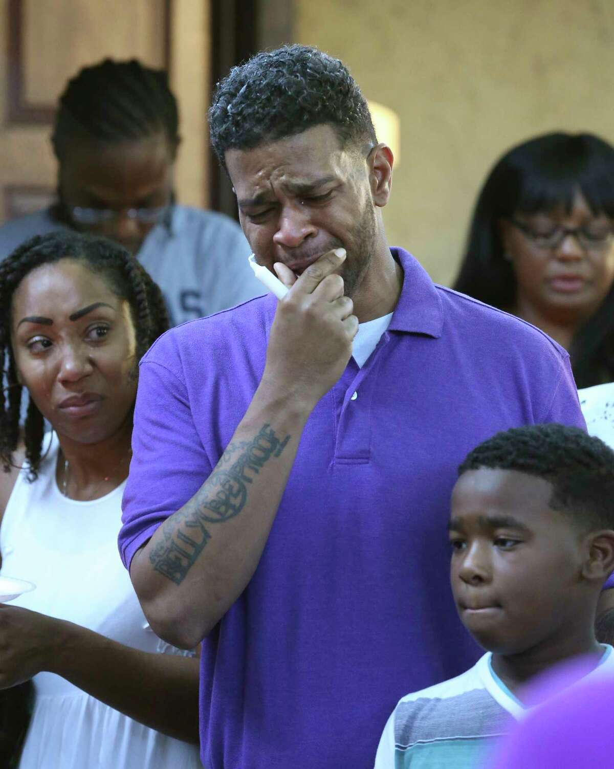 Quincy Russell struggles with grief as friends and family gather on June 6, 2017 to remember, in a prayer vigil, April Russell who was fatally shot by her ex boyfriend on on Monday.