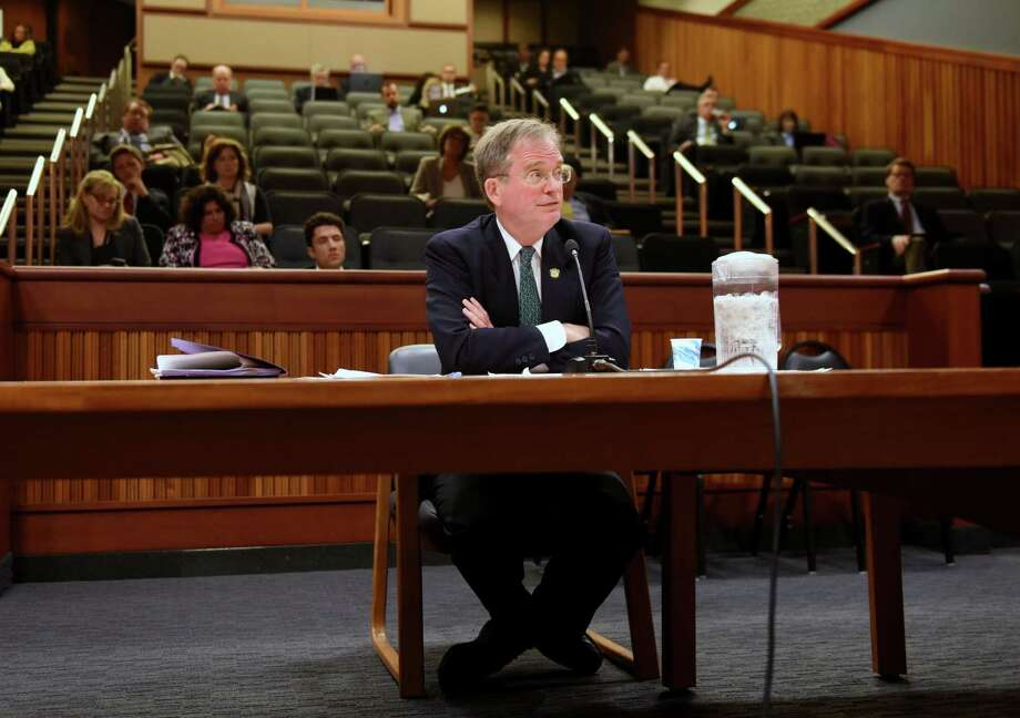 John Rhodes, Governor Cuomo's nomination of as chairman of the Public Service Commission (PSC), is questioned by Sen. John DeFrancisco during a hearing at the Legislative Office Building on Tuesday, June, 6, 2017, in Albany, N.Y. (Will Waldron/Times Union) Photo: Will Waldron