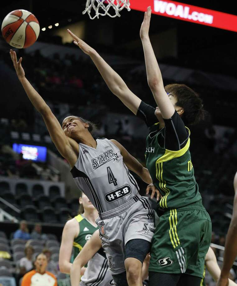 San Antonio Stars' Moriah Jefferson (04) drives to the basket against Seattle Storm's Ramu Tokashiki (07) during their game at the AT&T Center on Tuesday, June 6, 2017. (Kin Man Hui/San Antonio Express-News) Photo: Kin Man Hui, Staff / San Antonio Express-News / ©2017 San Antonio Express-News