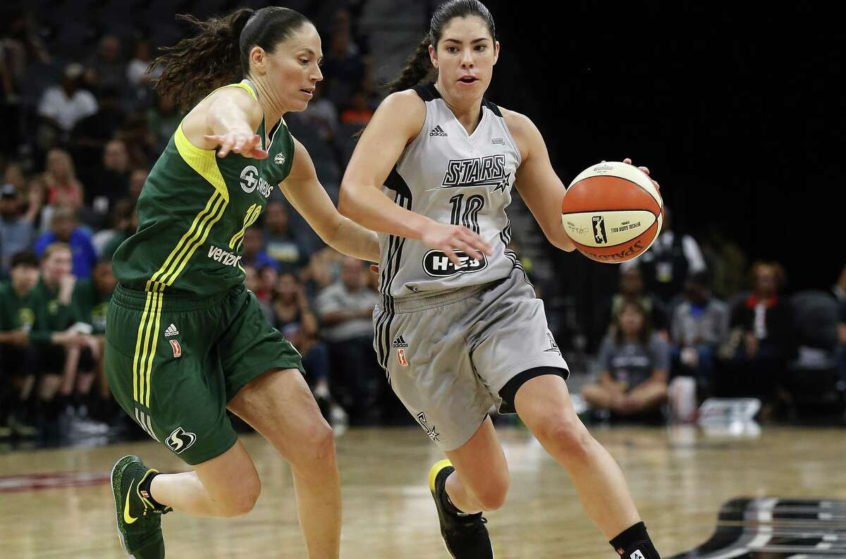Stars' Kelsey Plum pushes the ball up the court against the Seattle Storm's Sue Bird during the second half at the AT&T Center on June 6, 2017.