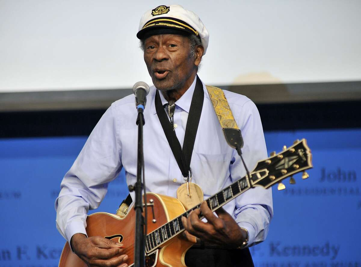 """FILE - In this Feb. 26, 2012 file photo, Chuck Berry plays """"Johnny B. Goode"""" at the John F. Kennedy Presidential Library and Museum in Boston, an event where he and Leonard Cohen were honored with Awards for Song Lyrics of Literary Excellence. Berry died March 18, 2017 at the age of 90. His last album, """"Chuck,"""" will be released on Friday, June 9, a fitting finale from the man who melded blues, rhythm and blues and country music into a sound that changed the cultural landscape. (AP Photo/Josh Reynolds, File)"""