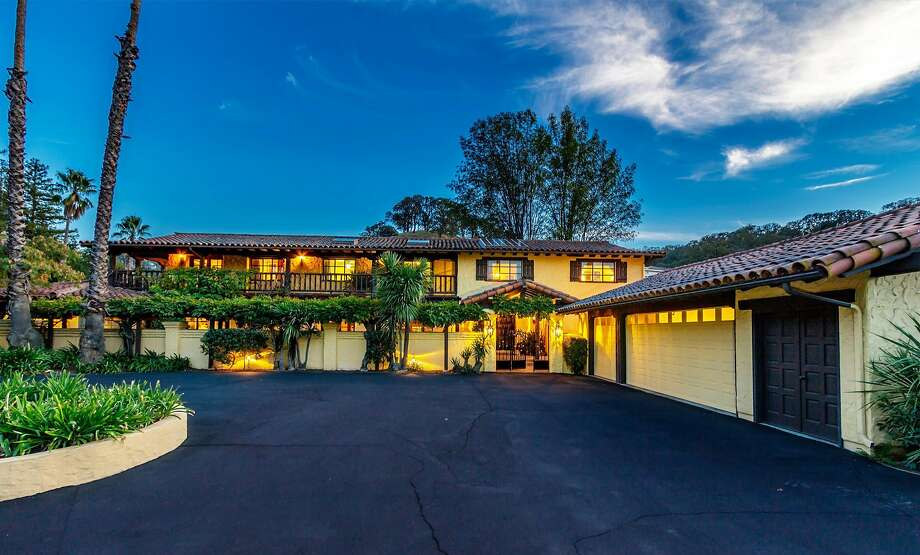 The home features a circular driveway. Photo: TourFactory