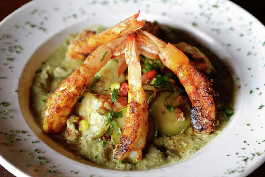 Camarones en pipian verde: blackened Gulf shrimp in green pipian sauce with toasted pepitas served with green poblano rice and sauteed Mexican squash at Arnaldo Richards' Picos restaurant which is introducing about 20 new menu items. Photo: Melissa Phillip, Houston Chronicle / © 2017 Houston Chronicle