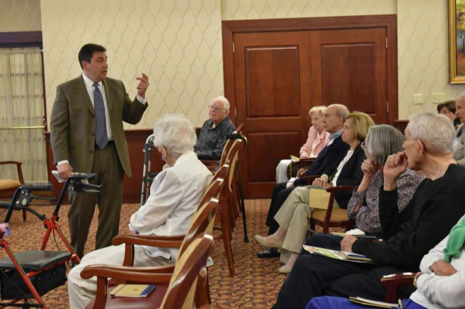 "Jerry Bosak, of the Bosak Funeral Home and a member of the Bosak Health and Wellness Elder Expert team speaks at ""The Talk of a Lifetime,"" workshop at Edgehill Senior Living Facility on May 25. The workshop addressed medical and legal issues surrounding caring for aging loved ones. Photo: Bosak Health And Wellness Elder Expert Team"