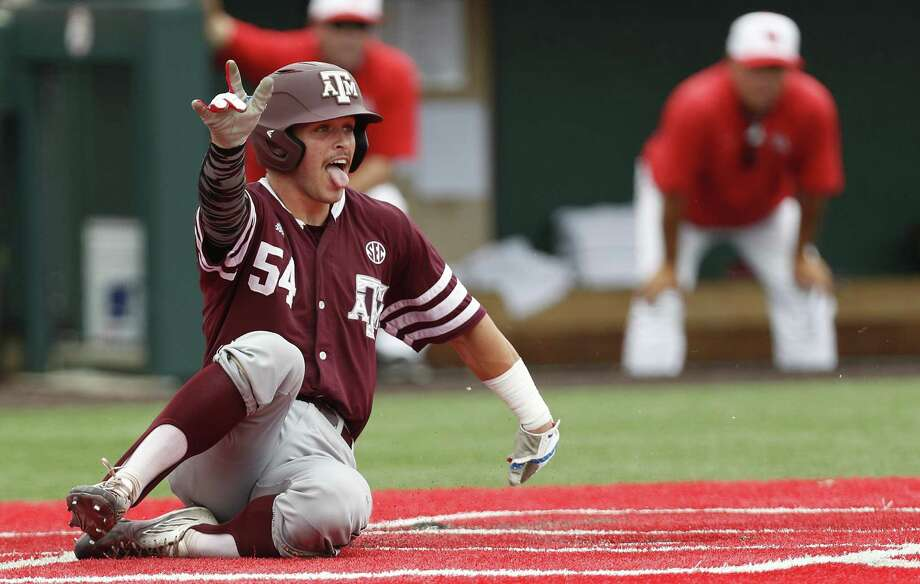 Texas A&M's Cole Bedford celebrates his run scored at home plate on an RBI single by Blake Kopetsky during the first inning of an NCAA regional playoff game against Houston at Schroeder Park, in Houston on June, 5, 2017. Photo: Karen Warren /Houston Chronicle / Internal