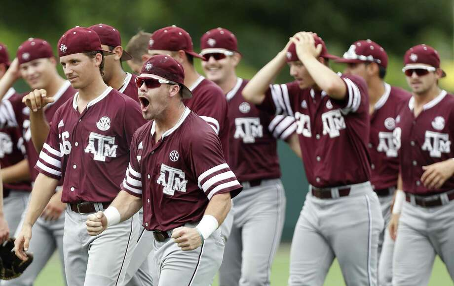 Texas A&M players celebrate after pulling out a 4-3 win over the Houston Cougars to win an NCAA regional baseball series at Schroeder Park, in Houston on June, 5, 2017. Photo: Karen Warren /Houston Chronicle / 2017 Houston Chronicle
