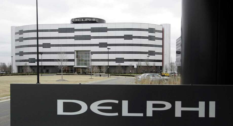 Delphi's World Headquarters is shown in Troy, Michigan in 2006. Automotive electronics and parts maker Delphi and French transport company Transdev have plans to use autonomous taxis and a shuttle van to carry passengers on roadways in France without a human behind the wheel as early as 2018. Photo: Carlos Osorio /Associated Press / Copyright 2017 The Associated Press. All rights reserved.