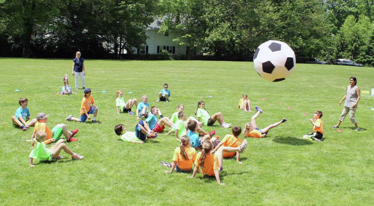 Students play World Cup soccer during a video game-themed field day at South School in New Canaan on June 2.