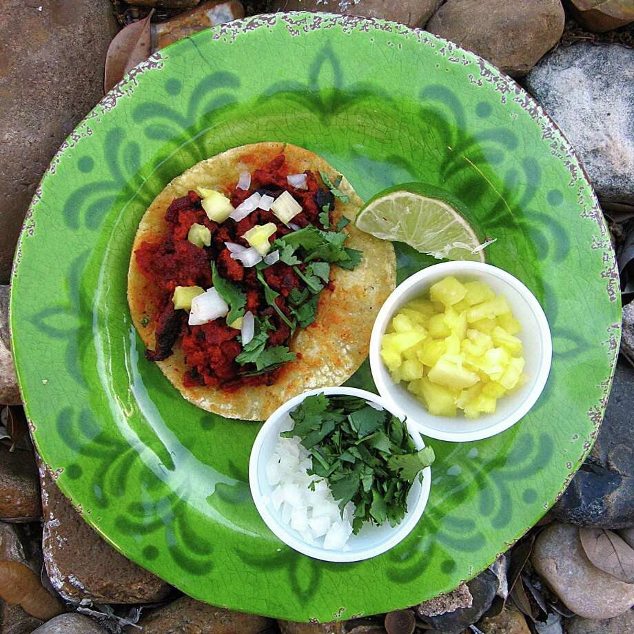 Al pastor taco on doubled-up mini corn tortillas from El Taco Grill. Photo: Mike Sutter /San Antonio Express-News