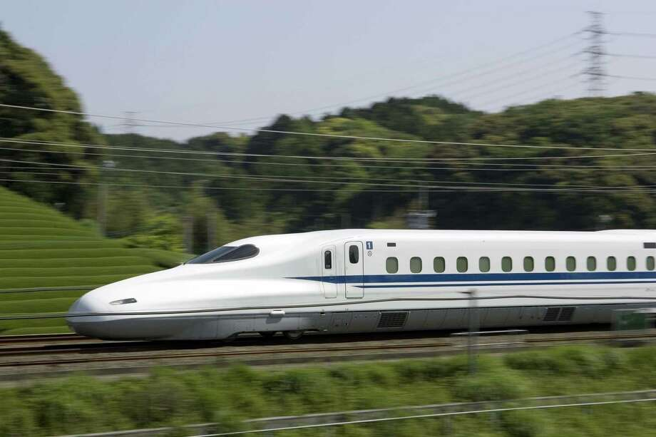 The planned high-speed rail line between Houston and Dallas would use overhead electrical lines and its own separated tracks to shuttle riders between the two metro areas, through mostly flat, rural land. The N700 train is shown in this photo illustration from Texas Central Railway, using images provided by Japan Railway Central. Photo: Texas Central Railway / Japan Railway Central / Texas Central Railway / Japan Railway Central