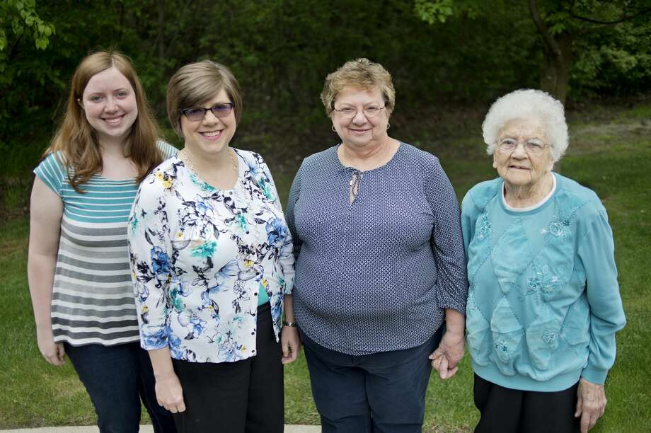 From left: Emily Kellogg, her mother Amy Kellogg, her grandmother Sharon McClain and her grandmother Donna Scott pose for a portrait Wednesday afternoon. All four women were valedictorians of their high school class. Photo: Brittney Lohmiller/Midland Daily News/Brittney Lohmiller