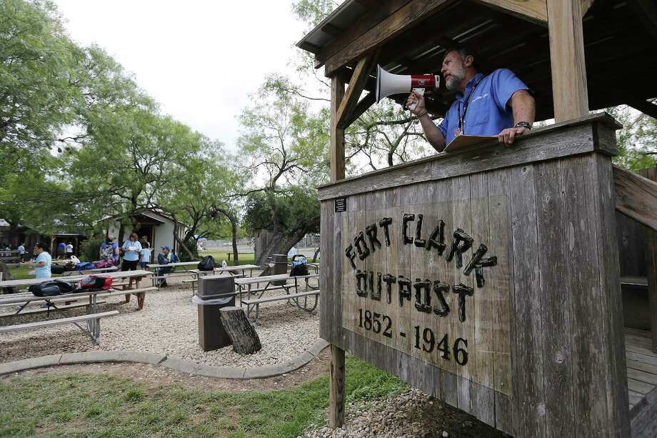 """Bradley Middle School teacher Michael Bailey addresses a tour at MillSprings Cabin at Bradley Middle School on Thursday, May 18, 2017. Bailey in the last month won both the H-E-B Lifetime Achievement award -- the highest teacher award, which gives $25,000 to him and $25,000 to his school -- and the Daughters of the Republic of Texas """"Outstanding 7th Grade Texas History Teacher Award,"""" giving $750 to him and $1,000 to his school. Bailey has taught at Bradley Middle School in NEISD for 24 years and not long after he started teaching at the school, he had the idea of bringing history to life and with the help of then-principal Bill Boyd brought a 180-year-old log cabin that originated from Kentucky onto the school campus. From there, Bailey expanded around the cabin and added several other buildings based on historical landmarks such as a general store, an old school, a livery all with the notion of enhancing students understanding of Texas history. Furthermore, Bailey has his students act as docents at the grounds which is called, MillSprings Cabin - a Texas Learning Facility. Students gain other skills like speech, public relations, problem-solving along with Texas history. So far, over 7,000 Bradley students have gone through the program according to Bailey. And over 40,000 students have visited and toured the facility. Bailey said he has seen former students venture into education and have even brought their children to tour the site. """"I've done it long enough that it's hit that point and it's just fun,"""" he said. """"The history will come and go. But the life skills that I'm teaching them out here, dealing with people, public relations, that makes you feel good."""" (Kin Man Hui/San Antonio Express-News) Photo: Kin Man Hui, Staff / San Antonio Express-News / ©2017 San Antonio Express-News"""
