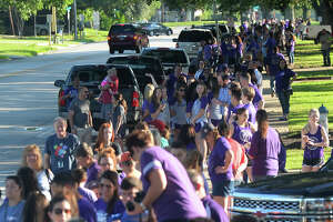 Indian fans line Merriman Street Wednesday to cheer the school's baseball team on as they leave for the State Tournament. The Indians play their first game at 4 p.m. Thursday against Wakeland High School in Austin. Photo taken Wednesday, June 07, 2017 Guiseppe Barranco/The Enterprise