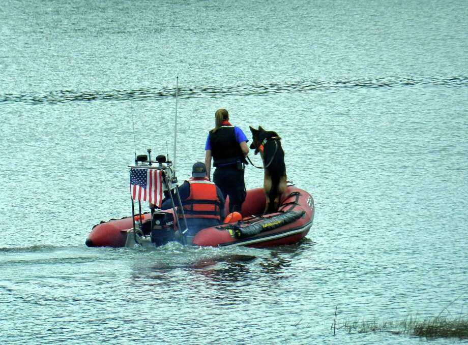 First responders search for the body of a person believed to have fallen into the Housatonic river late Tuesday night near Stratford, Conn. June 7, 2017. Photo: Contributed Photo / Jamie Rock / Contributed Photo / Connecticut Post