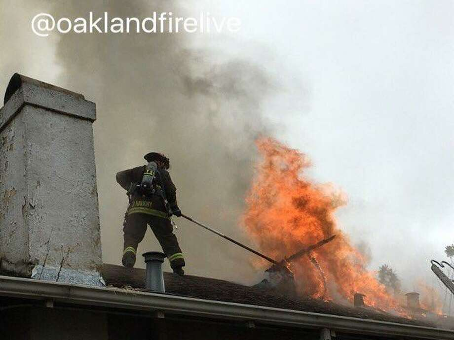 A house caught fire Wednesday morning in Oakland and firefighters were working to contain the fire to one home, officials said.