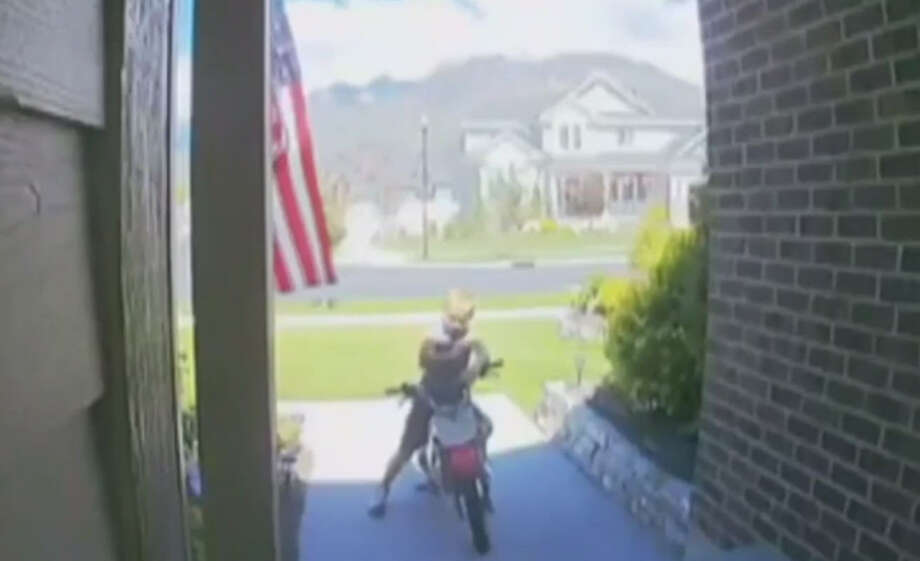 A little boy stops his motorbike for a moment to pledge allegiance to the flag as it waves on the front porch of a Utah home. If you feel a little low on your patriotism lately, continue clicking to see our suggestions for the most patriotic movies of all time. Photo: Ring.com Screenshot