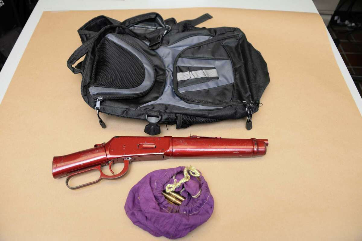 Schenectady police released images of a bag containing a loaded sawed-off rifle with ammunition that police say was thrown from 535 Mumford St., Schenectady, on Monday, June 5, 2017. (Schenectady Police Department)