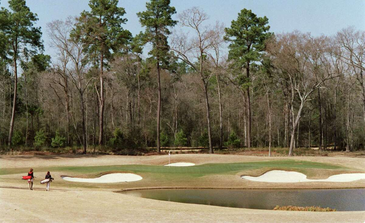The walk up to the green at the par three 12th on Carlton Woods in the Woodlands. -- for golf tab. 3/5/02 Karl Stolleis/Houston Chronicle. HOUCHRON CAPTION (03/17/2002): The Club at Carlton Woods lives up to its name as golfers approach the green at the par-3 No. 12. HOUSTON GOLF GUIDE 2002. HOUCHRON CAPTION (12/11/2002): The picturesque par-3 12th hole is one of the reasons Golf Digest has ranked The Club at Carlton Woods so high.