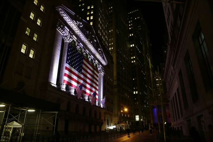 FILE - In this Friday, Feb. 17, 2017, file photo, an American flag hangs on the front of the New York Stock Exchange hours after the market closed, in New York. Technology and health care stocks are leading U.S. market indexes slightly higher in early trading on Wall Street, Wednesday, June 7, 2017. (AP Photo/Peter Morgan, File)