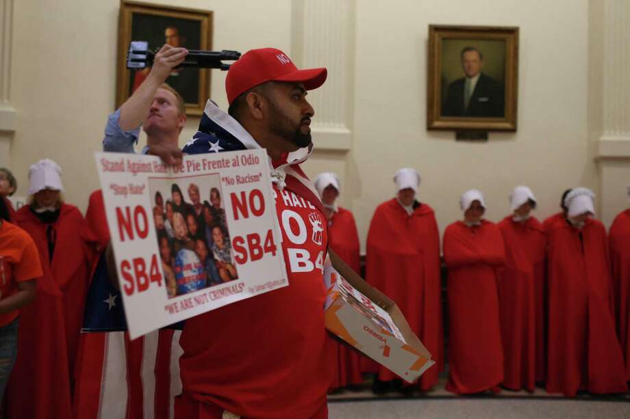 Opponents of SB 4 protest at the Capitol last month in Austin. Hundreds of people are expected to assemble in protest of the law, and possibly some counterprotesters, outside of a federal court hearing over SB 4 set for Monday, officials said. Photo: Jerry Lara /San Antonio Express-News / 2017 San Antonio Express-News