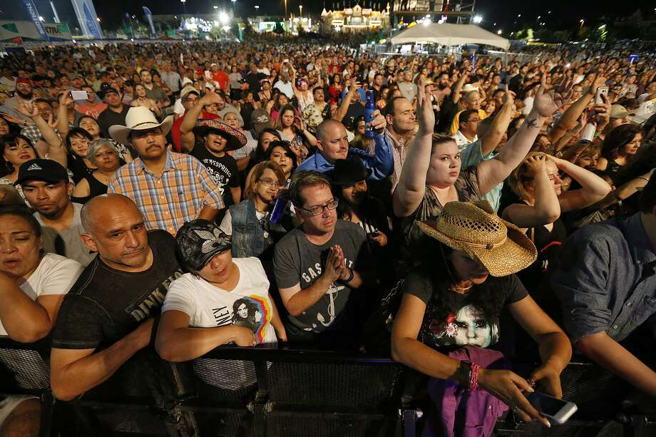 The crowd watches Eddie Money perform during the 2017 Fiesta Oyster Bake. A detention deputy with the Bexar County Sheriff's Department received a 15-day suspension for repeatedly cursing at his estranged wife and calling her derogatory names while working private security at the Fiesta event. Photo: Edward A. Ornelas /San Antonio Express-News / © 2017 San Antonio Express-News