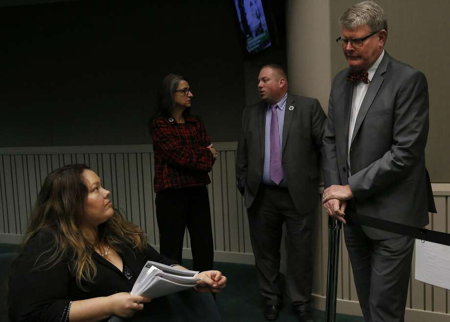 Jennifer Rodriguez, executive director of the nonprofit Youth Law Center in San Francisco, chats with Assemblyman Mark Stone, D-Santa Cruz, at a Sacramento hearing on youth in foster care. Photo: Leah Millis, The Chronicle