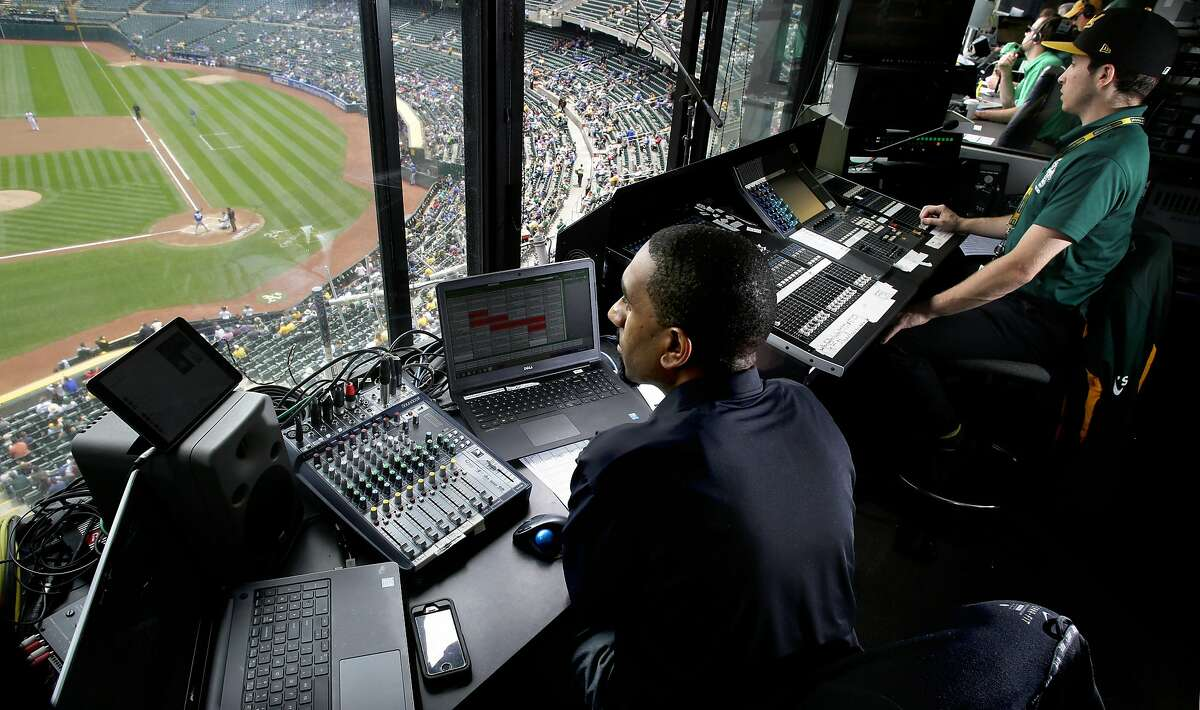 DJ Lee Merritts, (left) plays the music as Dustin Cooper operates the sound board from upstairs as the Oakland Athletics take on the Toronto Blue Jays in MLB action at the Oakland Coliseum on Wednesday June 7, 2017, in Oakland, Ca.