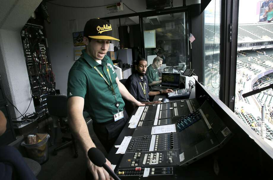 Engineer Dustin Cooper (left) operates the sound board as DJ Lee Merritts plays the music. When the A's began employing DJs in 1981, providing the music was a one-person job. Photo: Michael Macor, The Chronicle