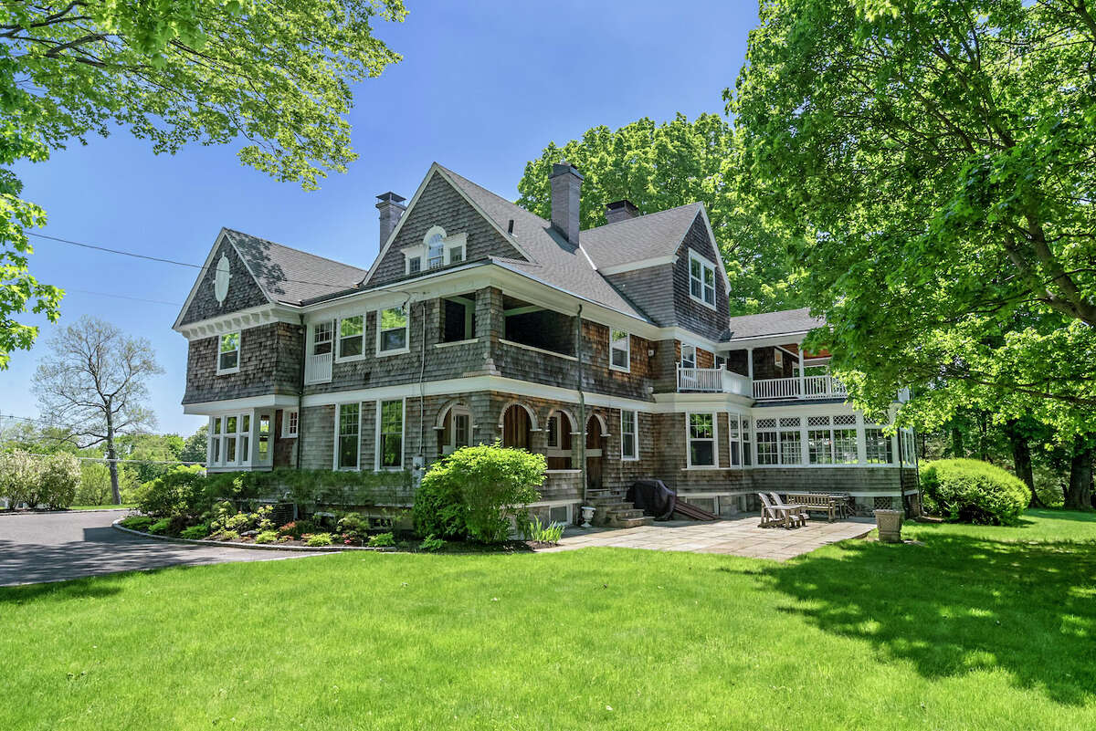 """""""Overlook,"""" at 35 High Ridge Avenue in Ridgefield, Conn. was built in 1882 along Publishers Row. Since then, four families have called the classic shingle-style house their home."""