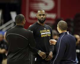 LeBron James (23) talks with Cavaliers Head Coach Tyronn Lue and former teammate Damon Jones, left, during an off-day practice before the Golden State Warriors played the Cleveland Cavaliers in Game 3 of the NBA Finals at Oracle Arena in Oakland, Calif., on Tuesday, June 6, 2017.