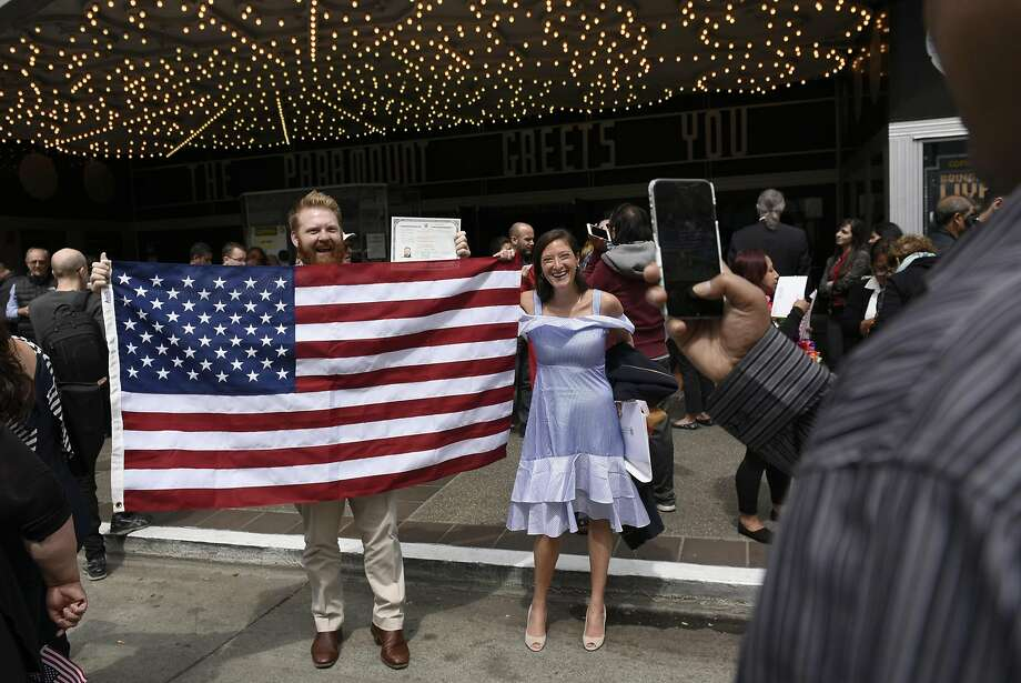 New U.S. citizen Dean Smith from Australia poses with fiancee Emily Greenberg. Photo: Michael Short, Special To The Chronicle