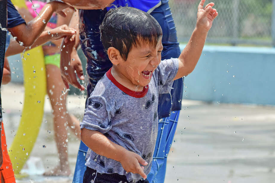 Two year old Luis Rodriguez reacts as water splashes in his face at the Dr. Cecilia May Moreno Splash Park Wednesday, June 07, 2017. Photo: Ulysses S. Romero