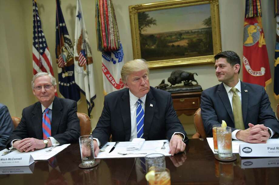 President Donald Trump is seated for a a lunch with Republican Party House and Senate leadership, including Senate Majority Leader Mitch McConnell and House Speaker Paul Ryan at the White House. The trio and their party generally have not been able to launch a policy platform because they don't have one. Photo: MANDEL NGAN /AFP /Getty Images / AFP or licensors