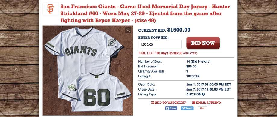 A screen grab shows the auction of Hunter Strickland's jersey with a $1,500 bid, before the auction was closed prematurely. Photo: Screenshot Via MLB.com